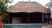 Thatch lapa and entertainment area by swimming pool