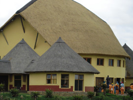 Mvezo Thatching Project - large curved thatch roof